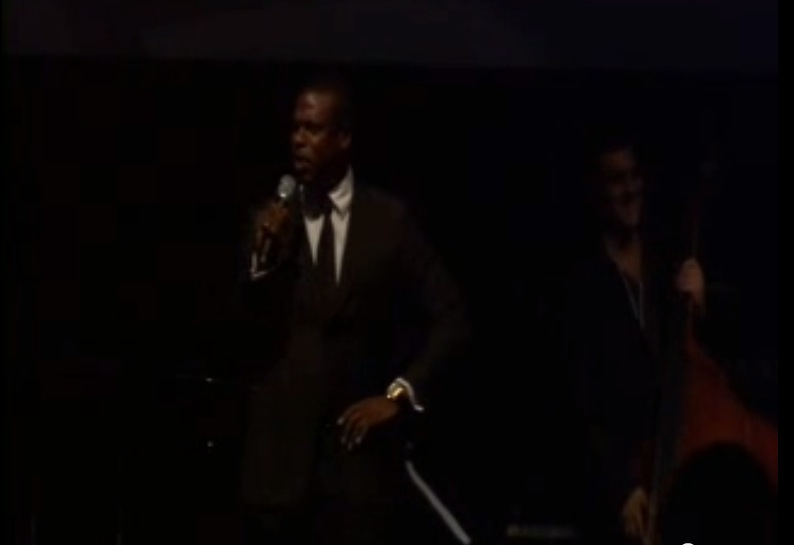 backing up Alan Cumming and Chris Tucker at amFAR, Antibes, 2010